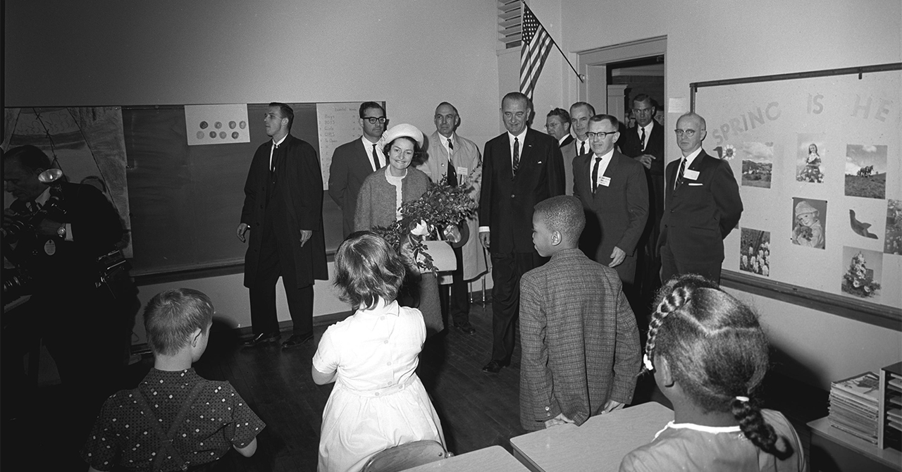 President Johnson and the First Lady meet students at a school in West Virginia during the War on Poverty tour
