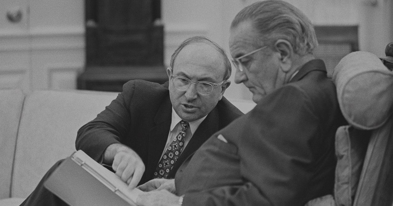 President Johnson and Wilbur Cohen talking