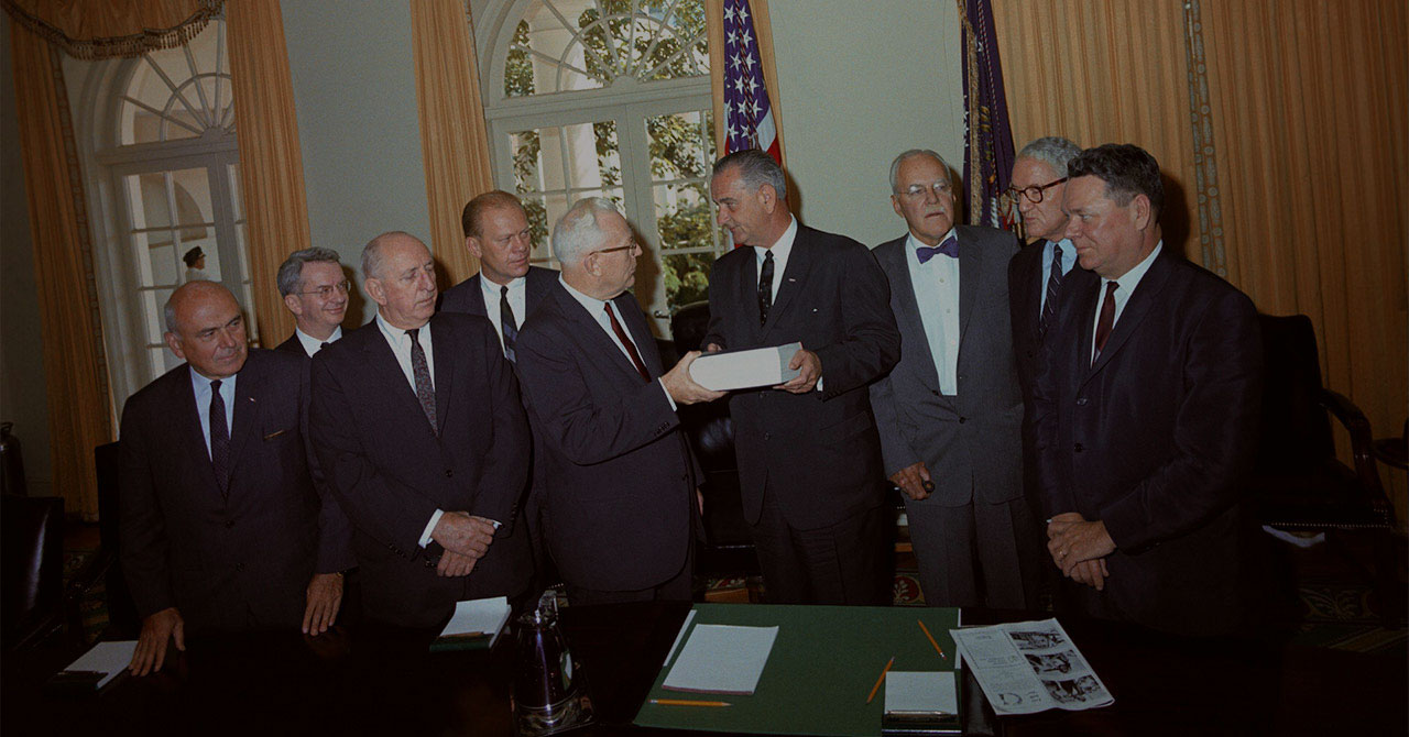 Members of the Warren Commission hand LBJ the report