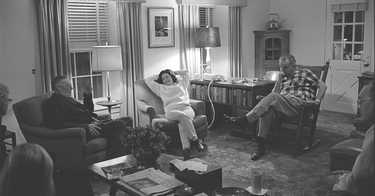 Group sitting around the LBJ Ranch living room