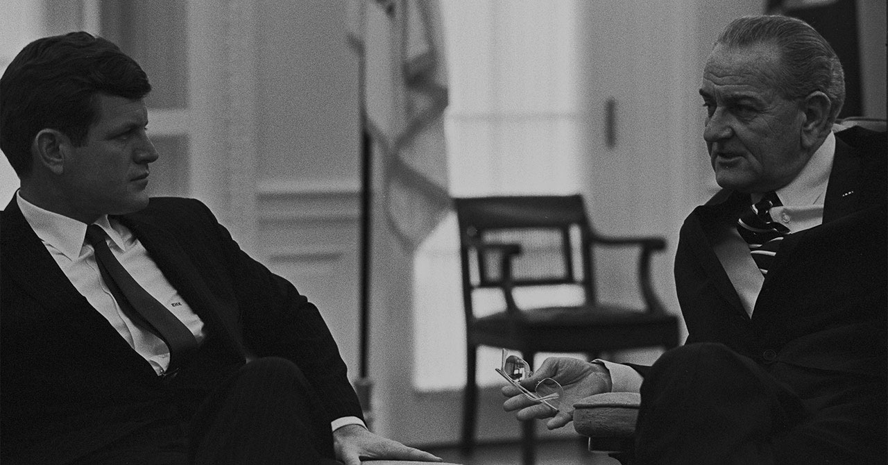 Edward Kennedy and LBJ sitting together in the Oval Office
