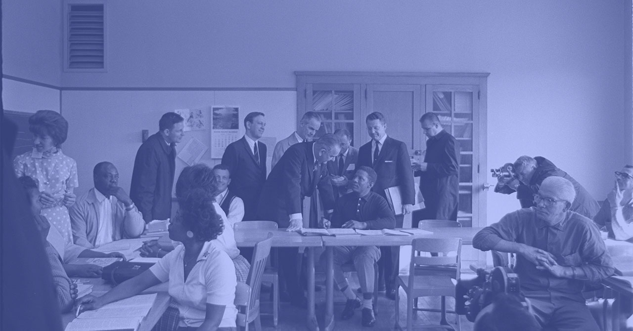 LBJ in classroom with adult students