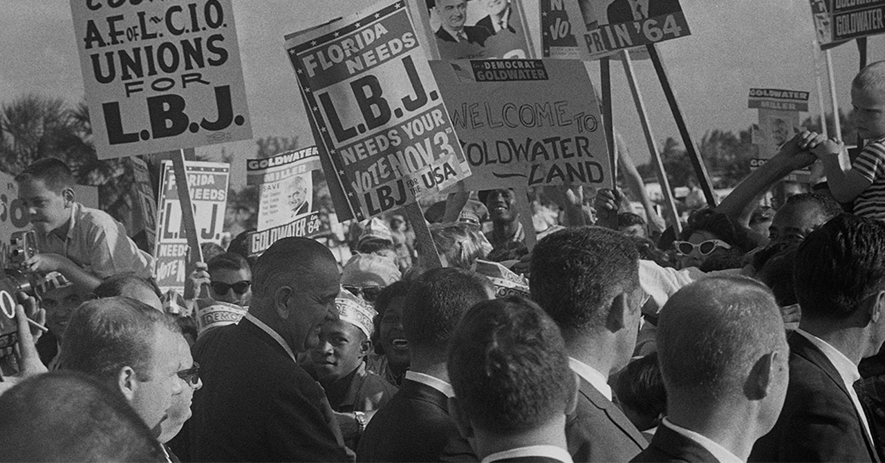 LBJ campaigning in a crowd of people