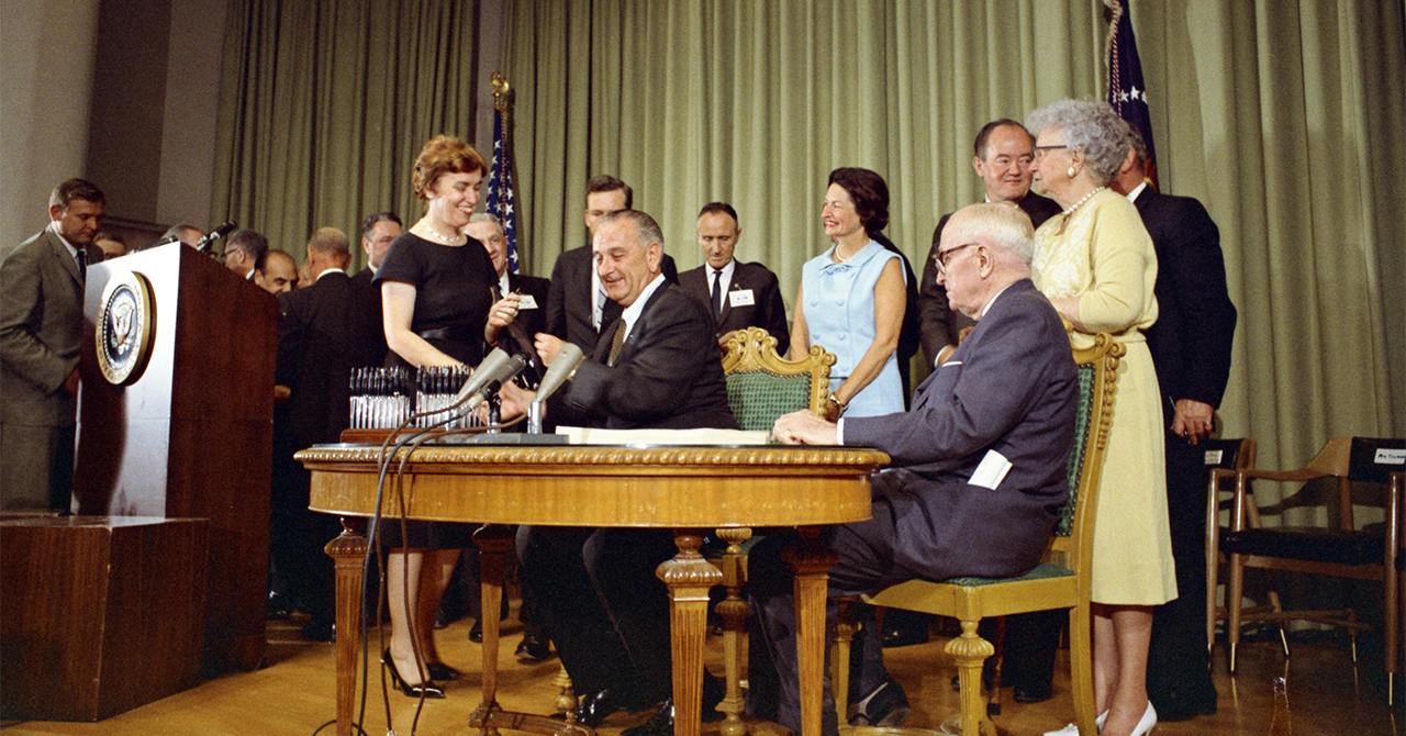 LBJ signing Medicare and Medicaid Act