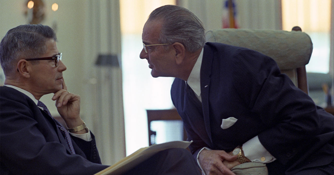 LBJ leaning in to talk to Secretary of Agriculture Orville L. Freeman