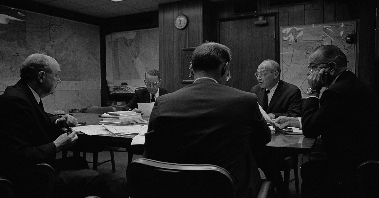 LBJ and advisors sitting around a table