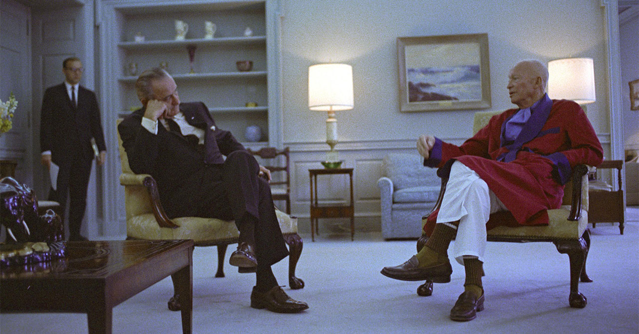LBJ and former President Dwight Eisenhower sitting in chairs