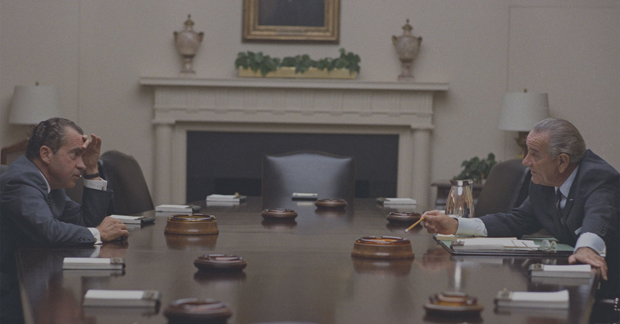Nixon and LBJ talking to each other across a table