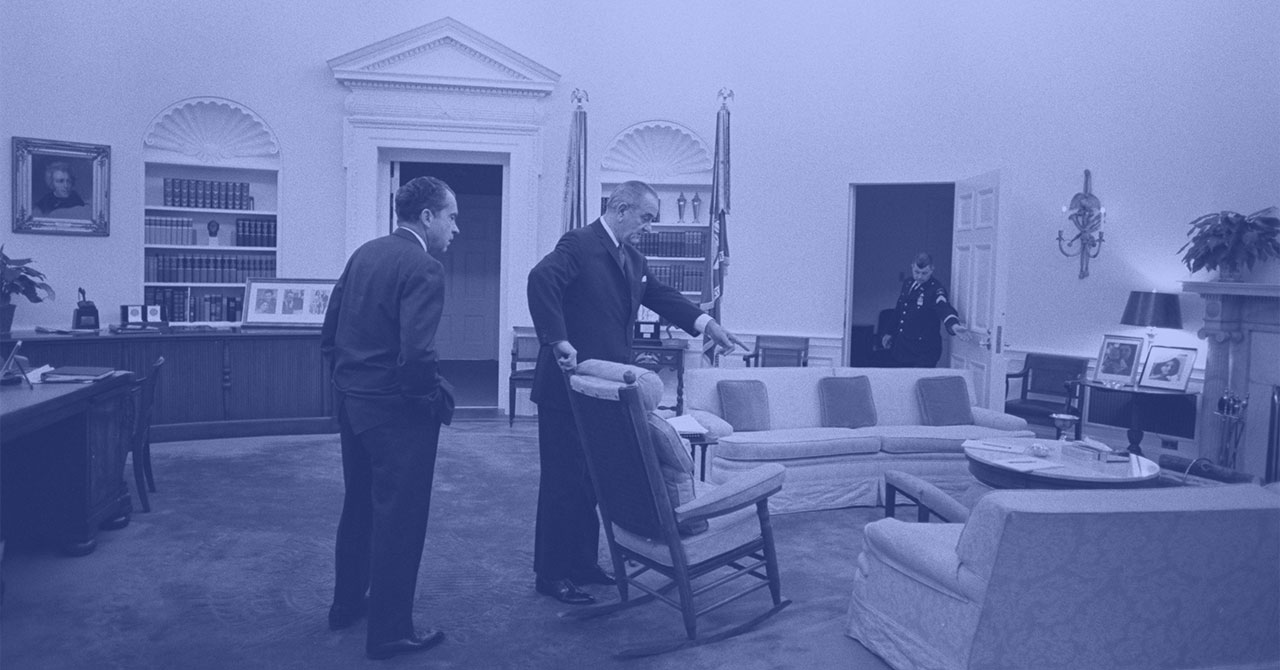 LBJ pointing to something in the Oval Office with Richard Nixon