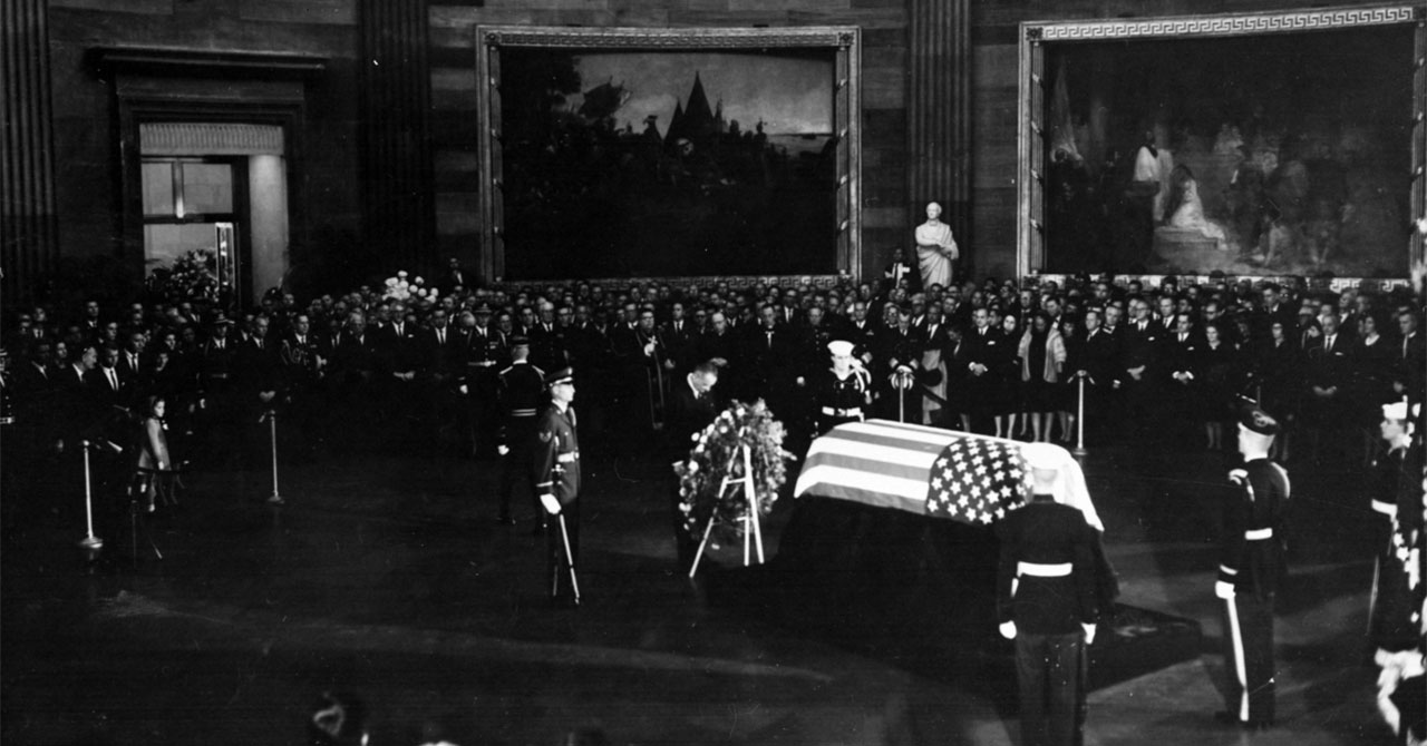 LBJ laying a wreath on President Kennedy's coffin