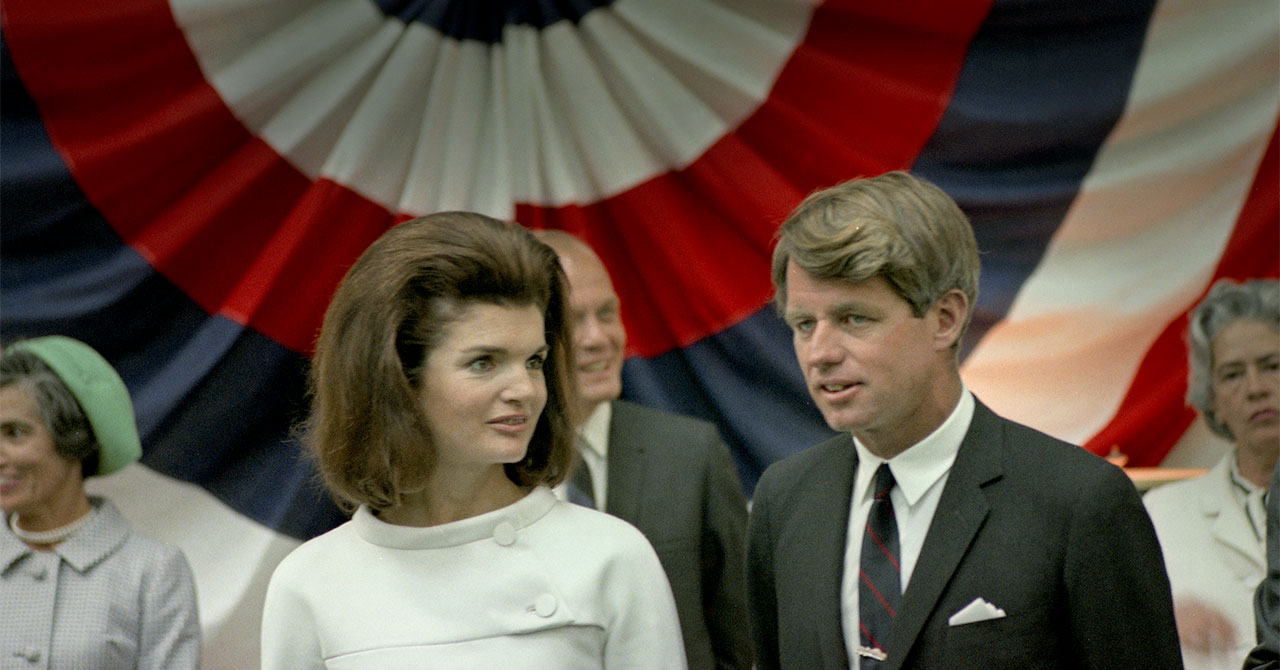Jackie Kennedy and Bobby Kennedy standing next to each other
