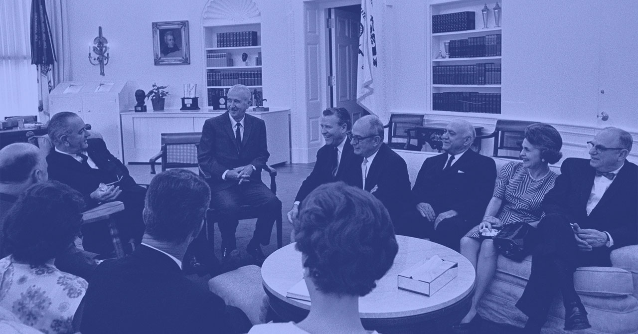 President Lyndon B. Johnson speaks with various judges and their wives