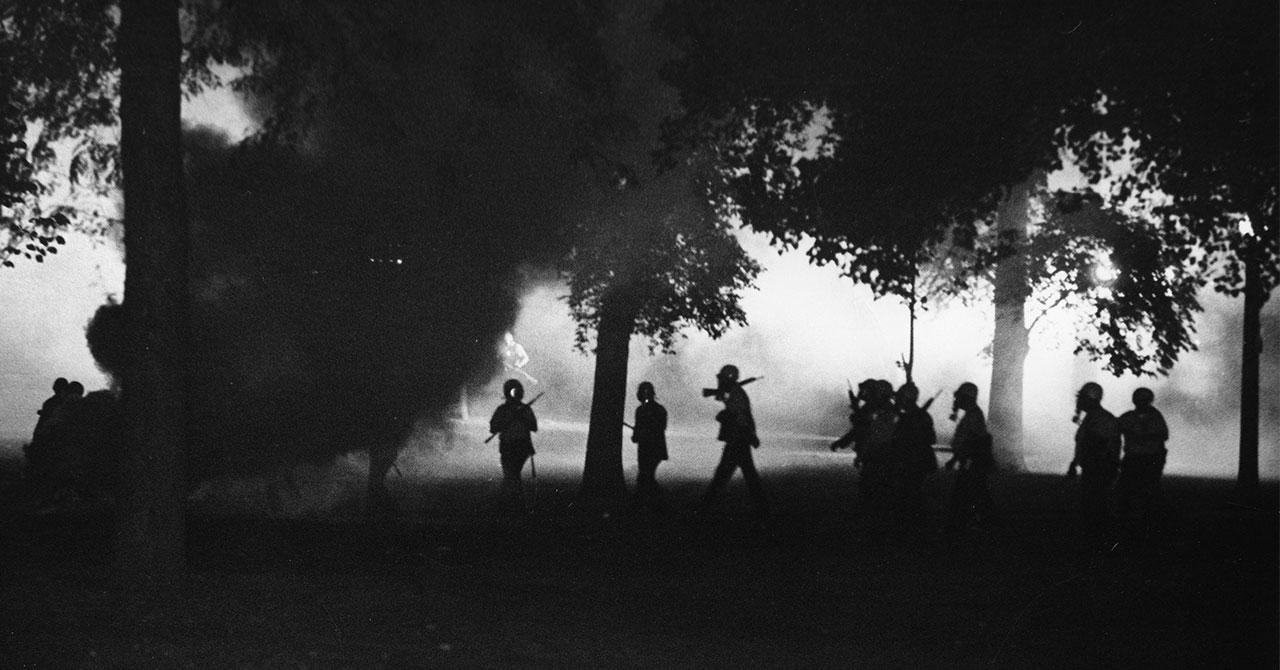 National guard troops walking amongst tear gas in Chicago, 1968